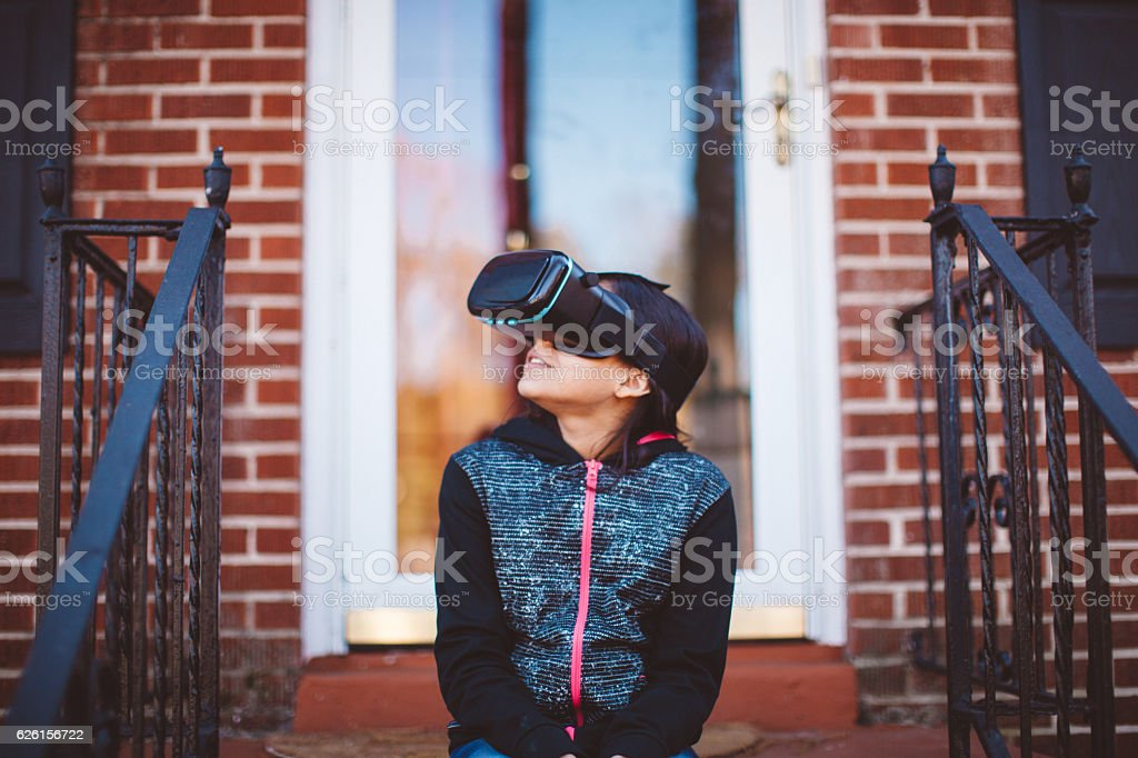 child using virtual reality goggles stock photo