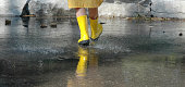 child walking in the rain