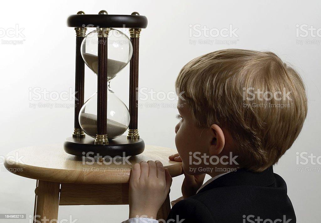 Child Watching Hourglass stock photo