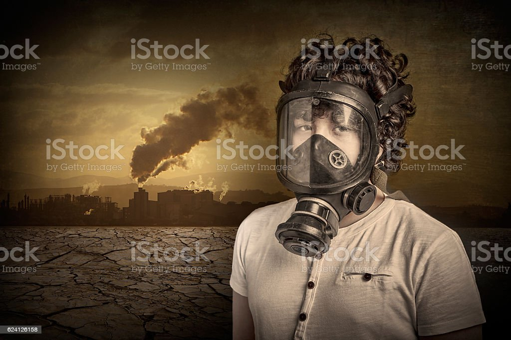 Child wearing a gas mask stock photo