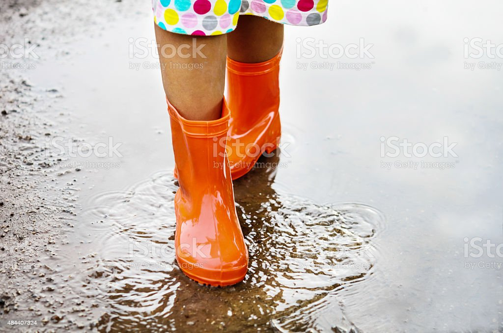 Child Wearing Orange Rain Boots stock photo 484407324 | iStock