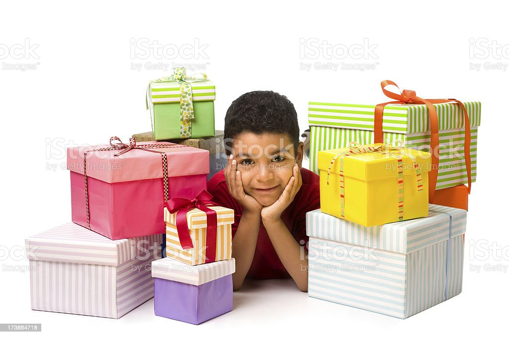 Child whit a stack of gifts royalty-free stock photo