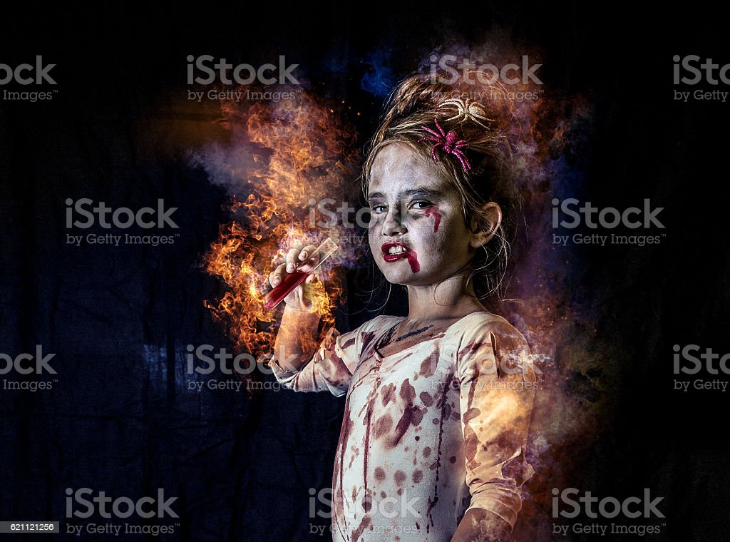 child witch drinking blood stock photo