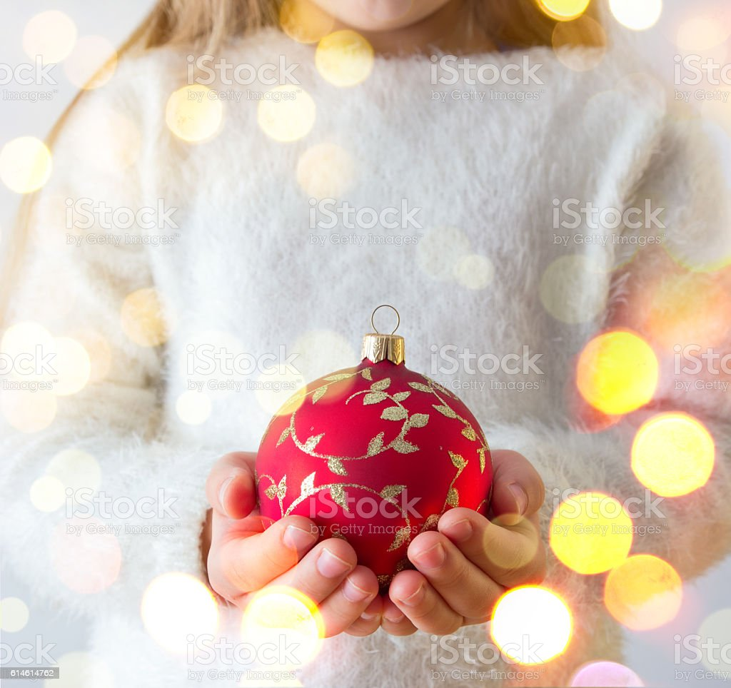 child with a christmas ball stock photo