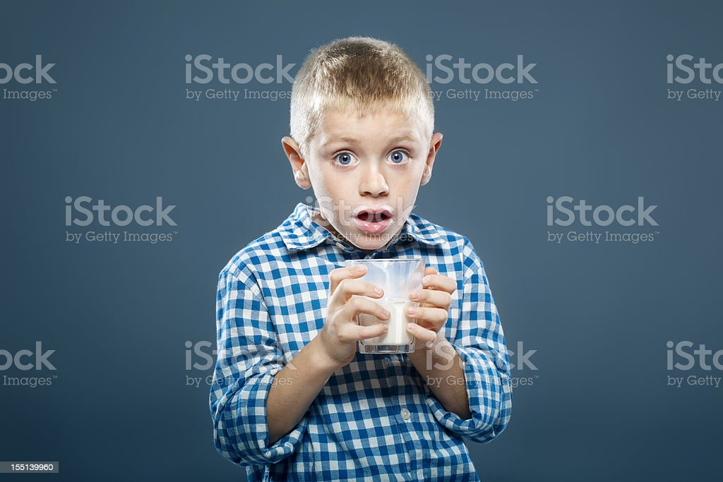 Child with a glass of milk royalty-free stock photo