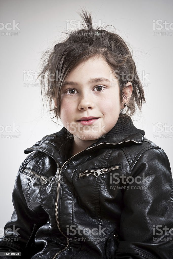 Child with a leather jacket. royalty-free stock photo
