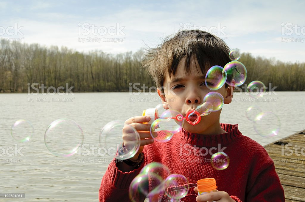 Child with a lot of bubbles royalty-free stock photo