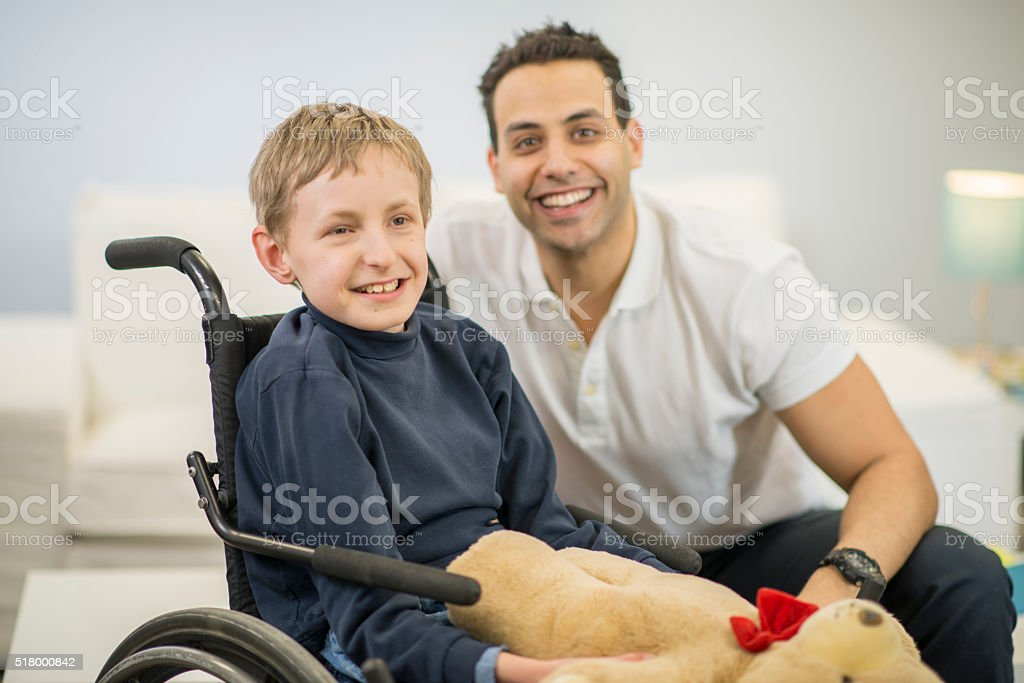Child with a Mental Disability Holding a Teddy Bear stock photo
