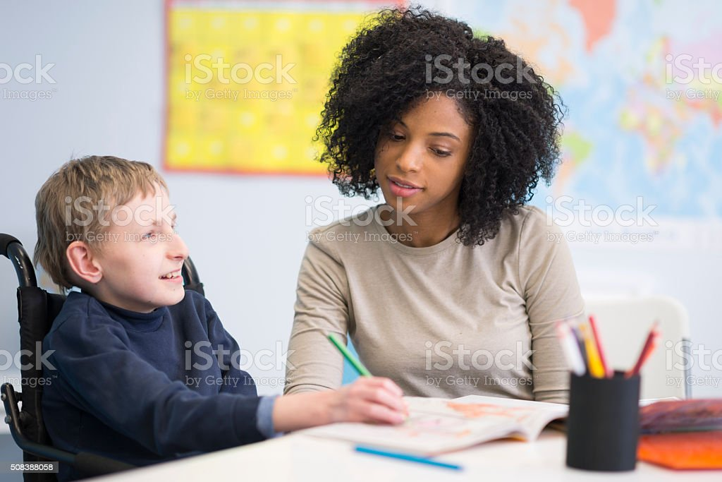 Child with a Physical Disability Drawing a Picture stock photo