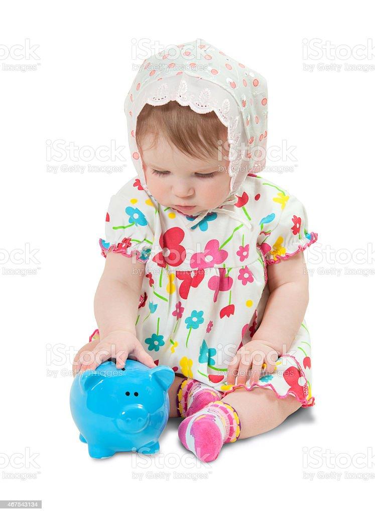 Kind mit einem Sparschwein auf weißem Hintergrund Lizenzfreies stock-foto