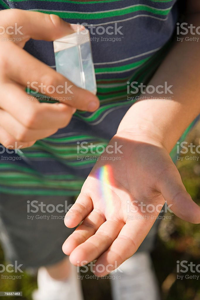 Child with a prism stock photo