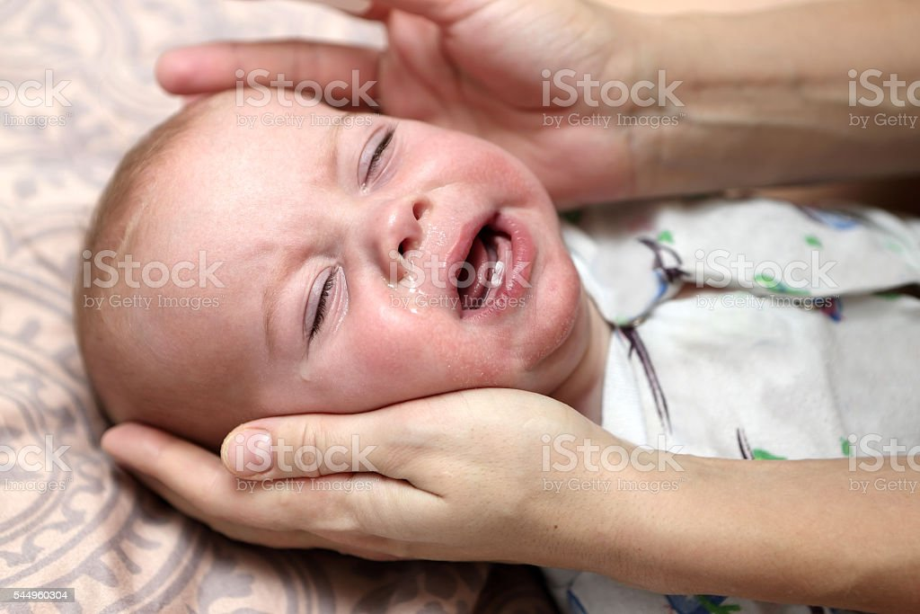 Child with a runny nose stock photo