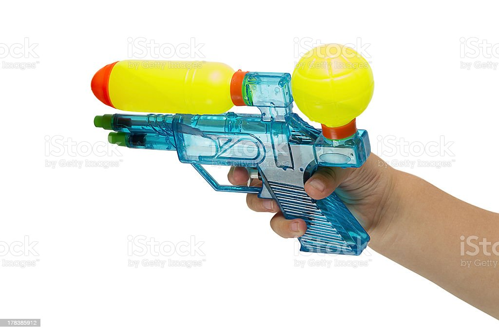 Child with a water pistol stock photo