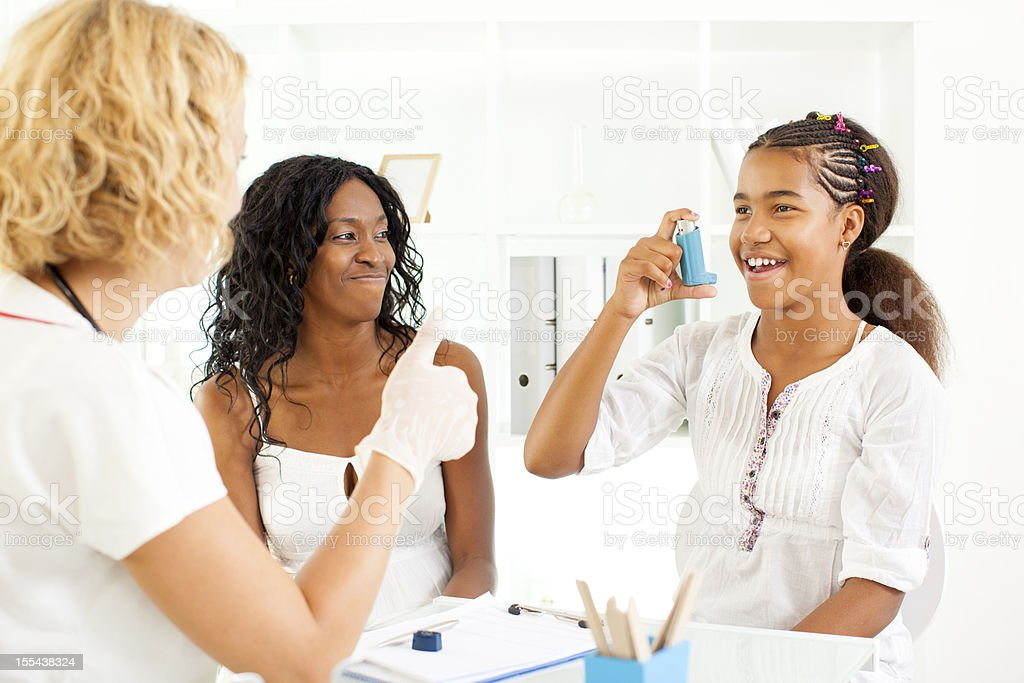 Child With Allergy Visit Doctor with her mother. stock photo