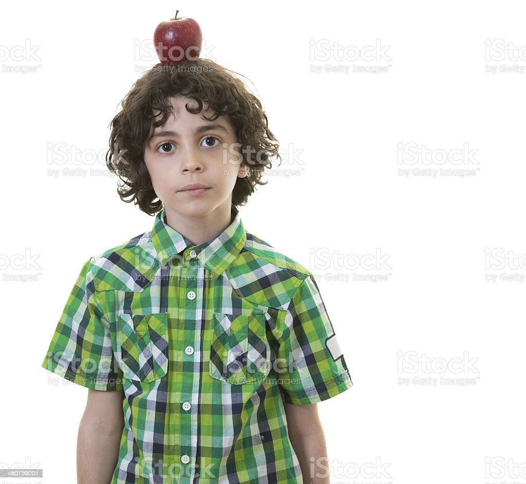 Child with apple in his head royalty-free stock photo