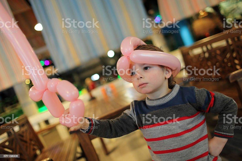 Child with balloon sword stock photo