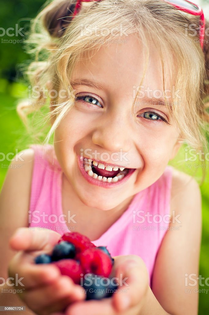 Child with berries stock photo