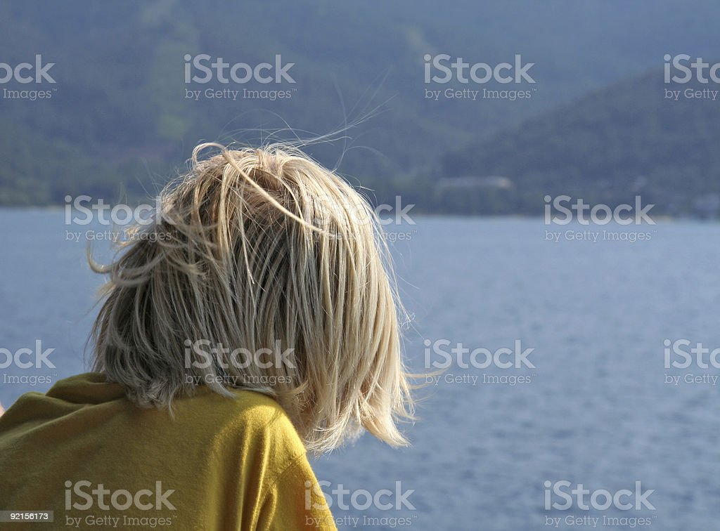 Child with blond hair on a ferry in Greece royalty-free stock photo