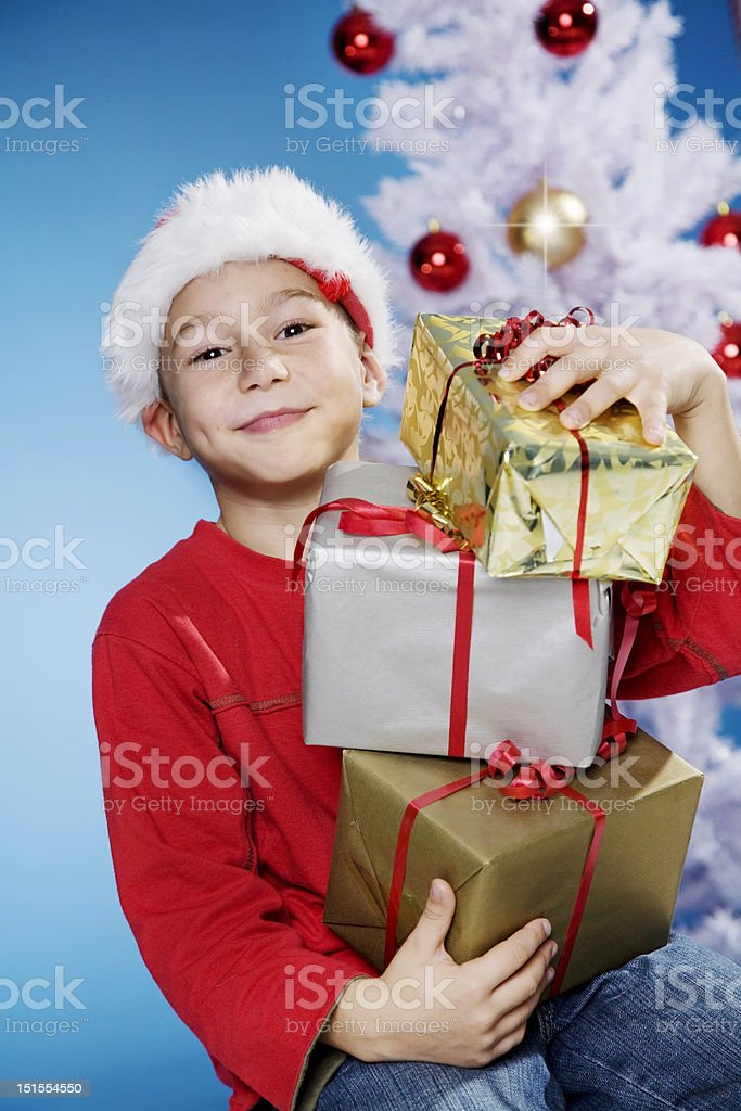 child with christmas presents stock photo