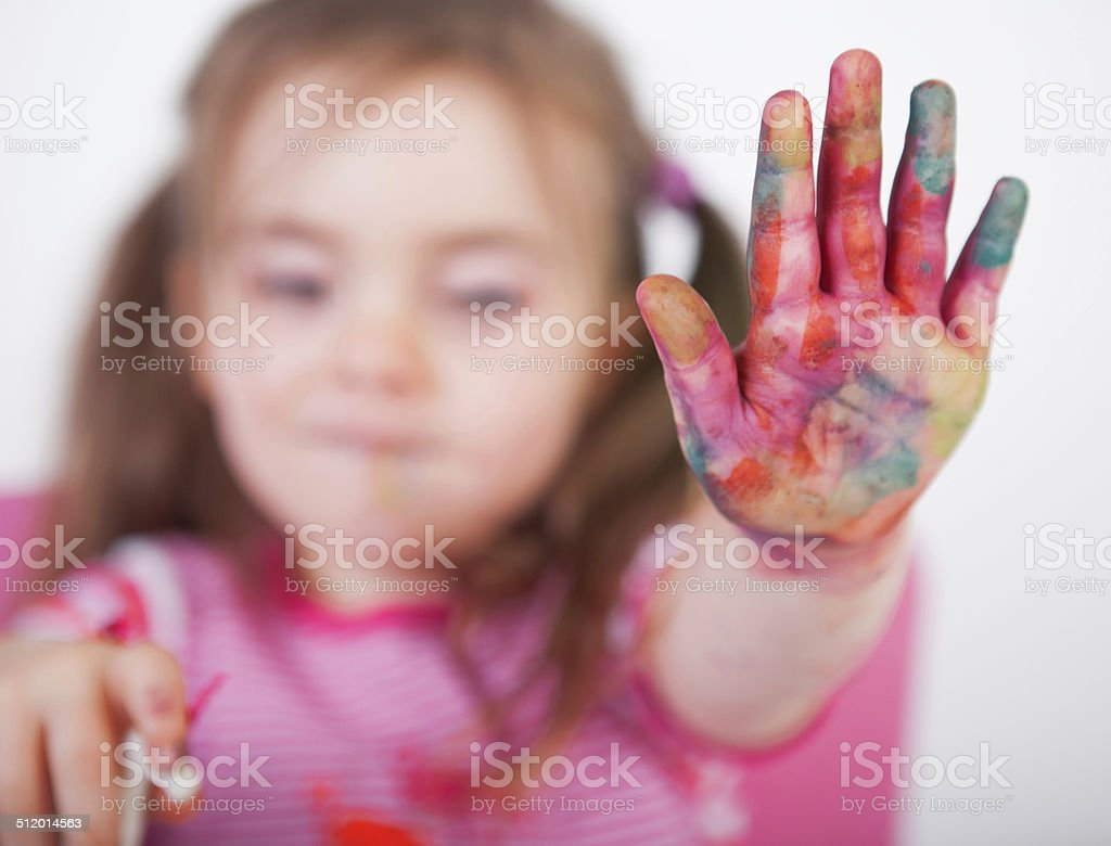 Child with colored hands stock photo