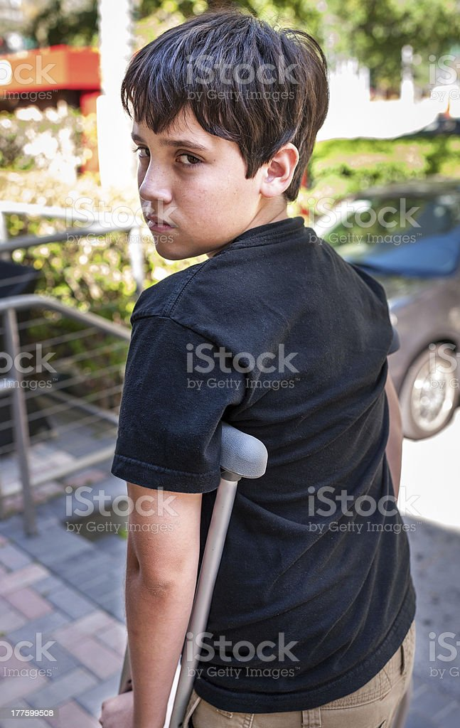 Child with crutches royalty-free stock photo