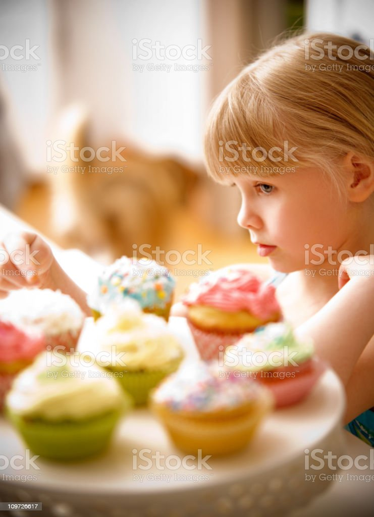 Child with Cupcakes royalty-free stock photo