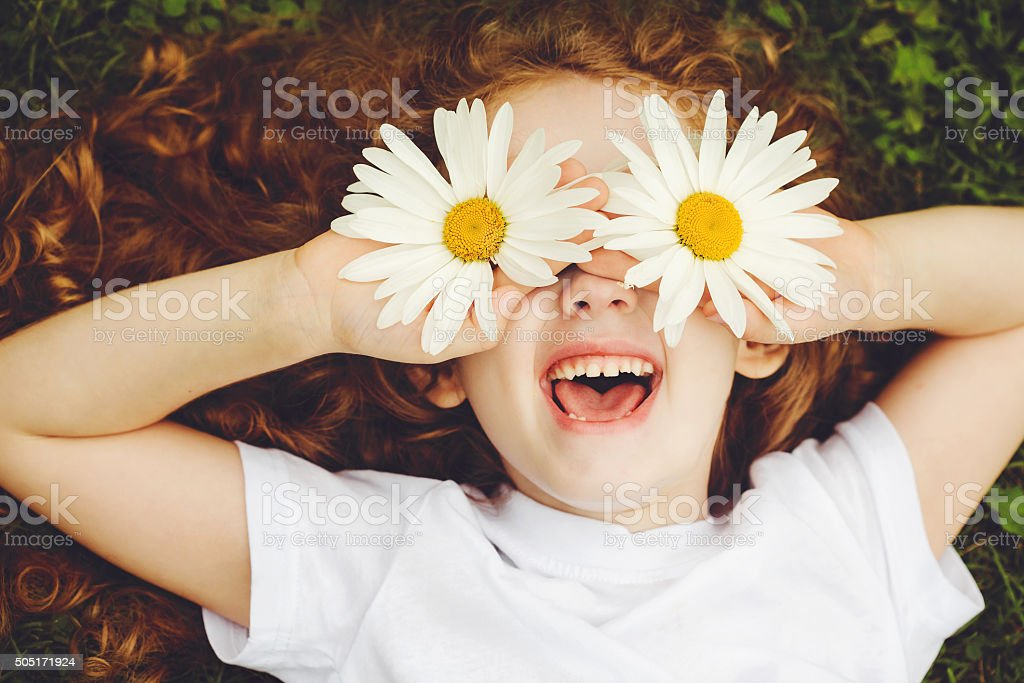 Child with daisy eyes. stock photo