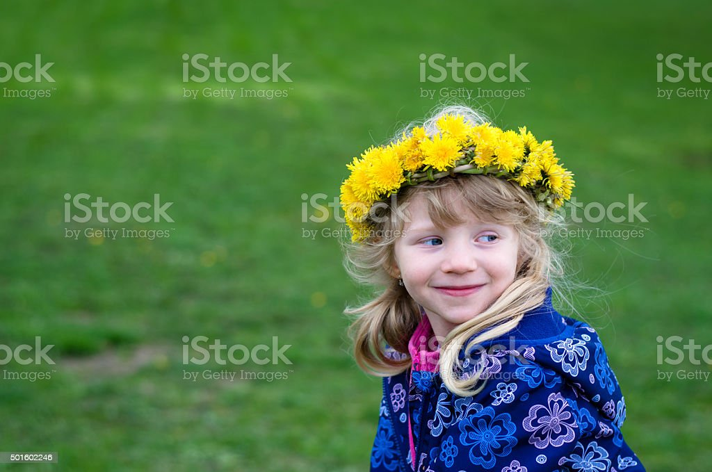 child with dandelion chain stock photo