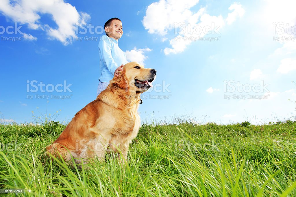 Child with dog outdoor. royalty-free stock photo