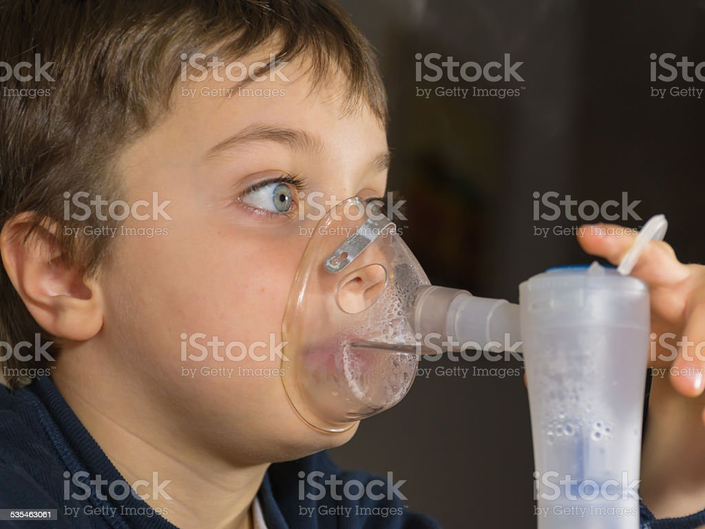 child with electric nebulizer stock photo