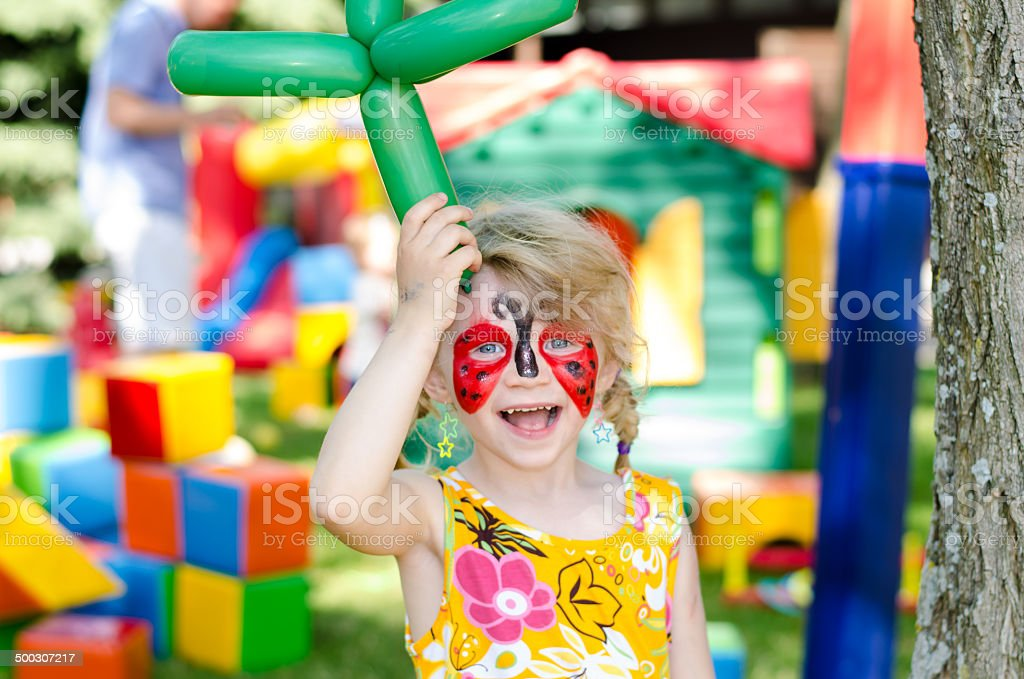 child with face painting stock photo