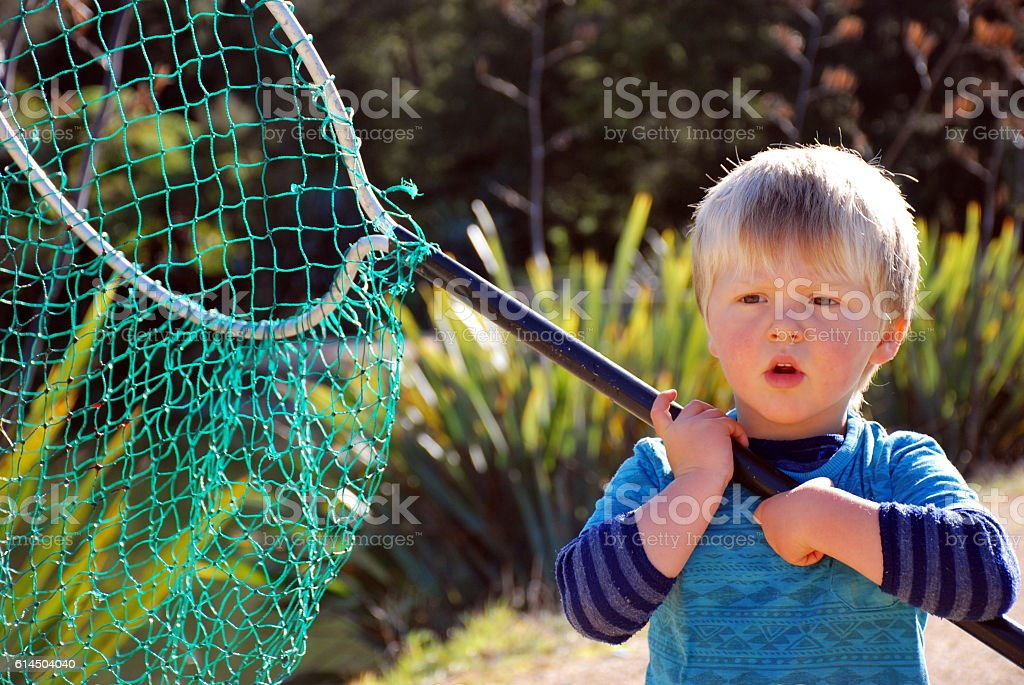 Child with Fishing Net, New Zealand stock photo