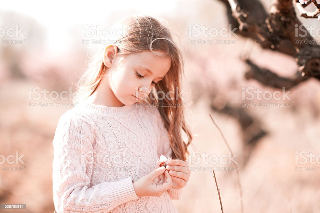 Child with flower stock photo