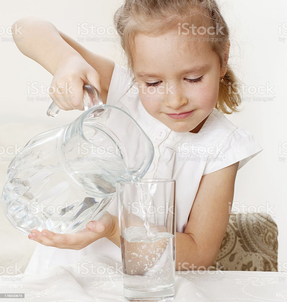 Child with glass pitcher water royalty-free stock photo