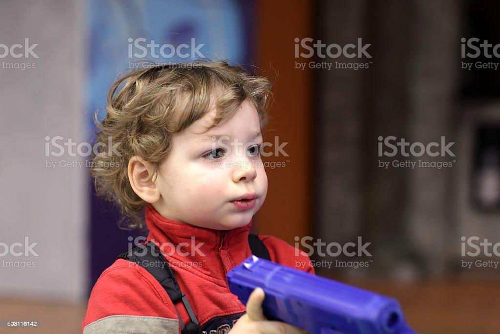 Child with handgun stock photo