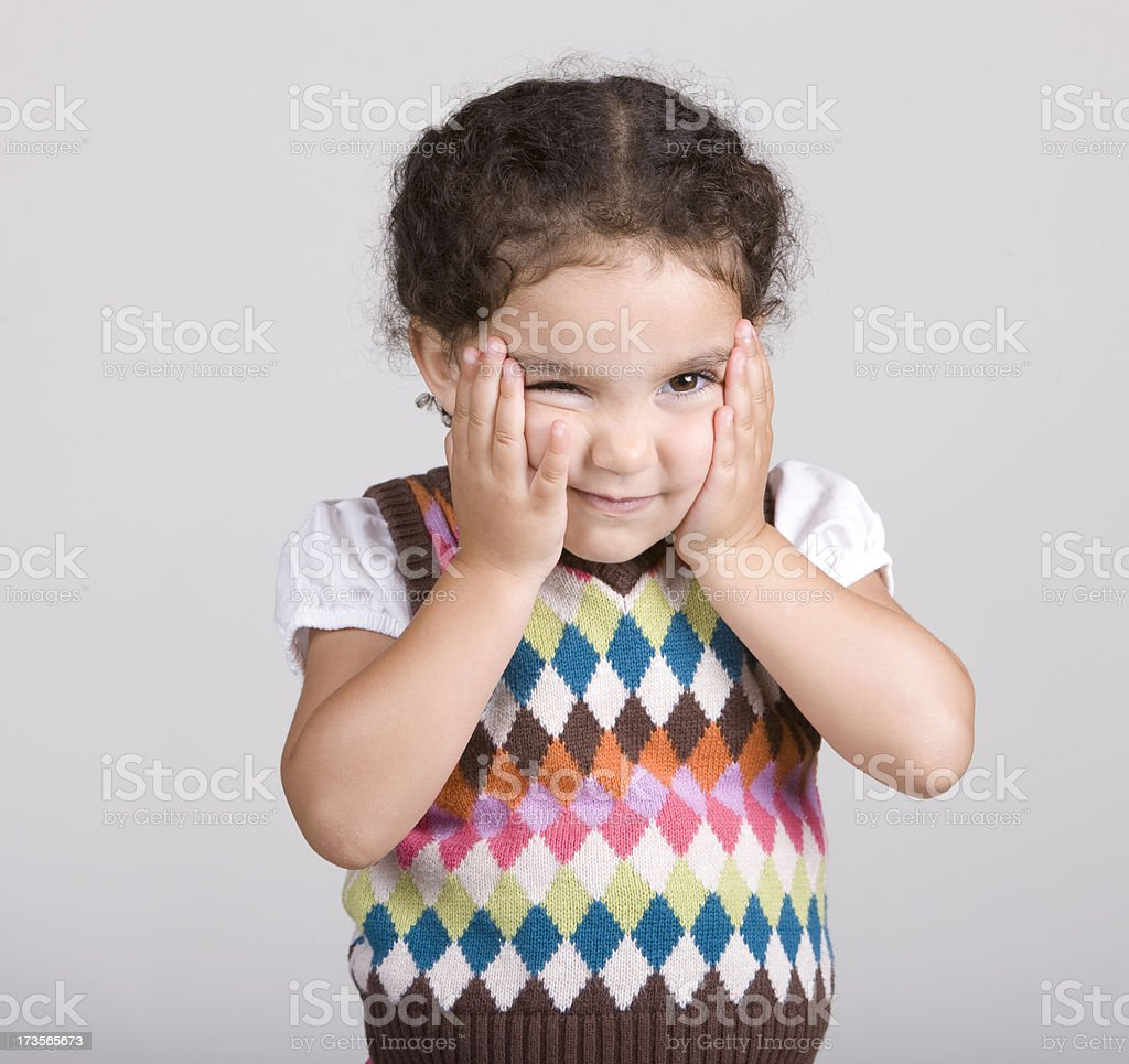 Child with Hands on Her Face royalty-free stock photo
