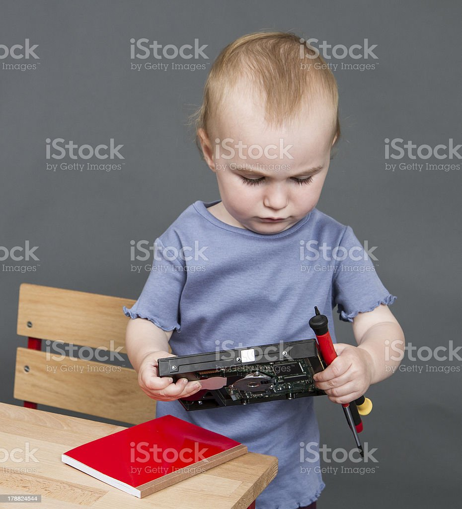 child with hard drive and tools stock photo