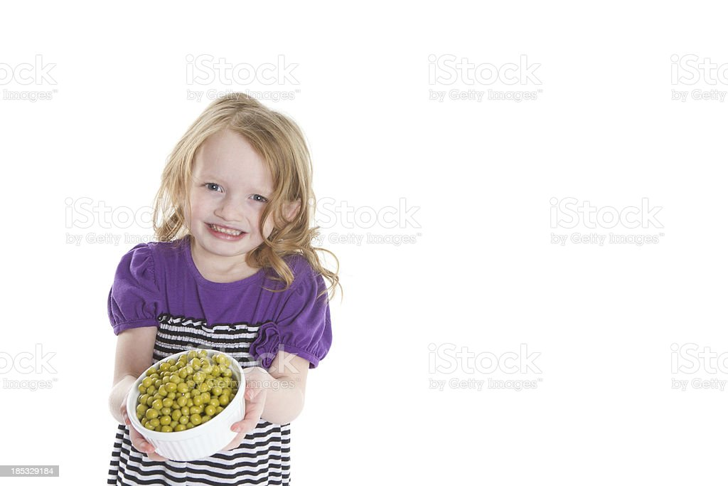 Child with her green peas royalty-free stock photo