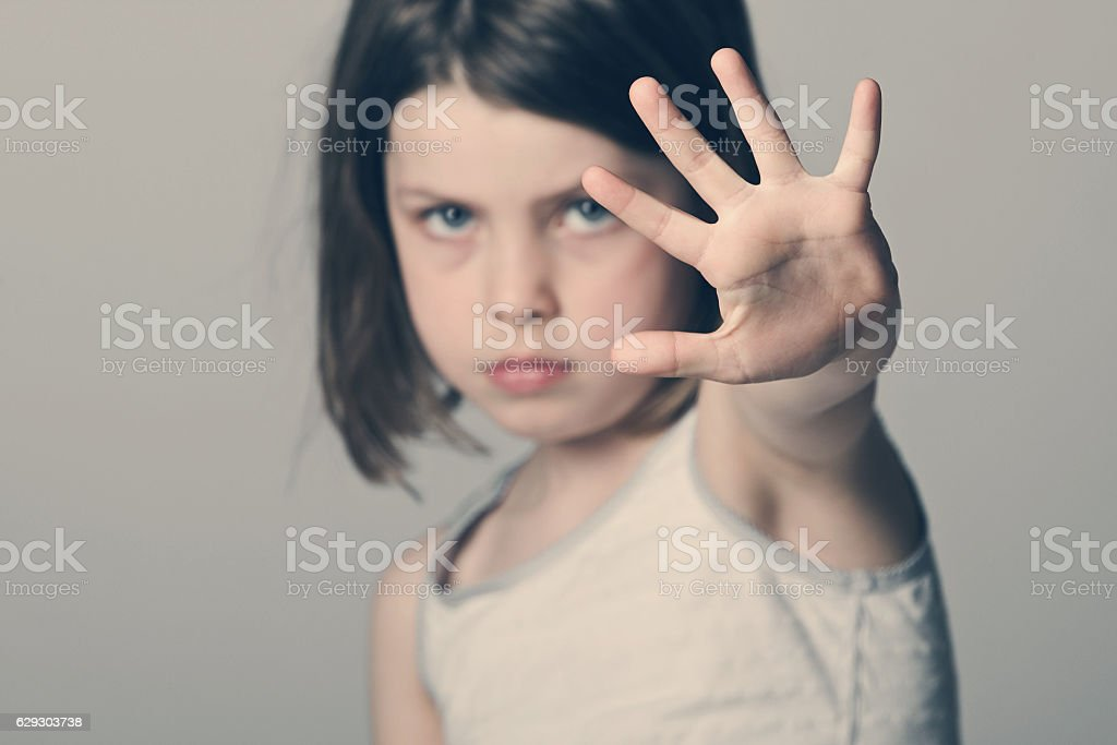Child with her hand up stock photo