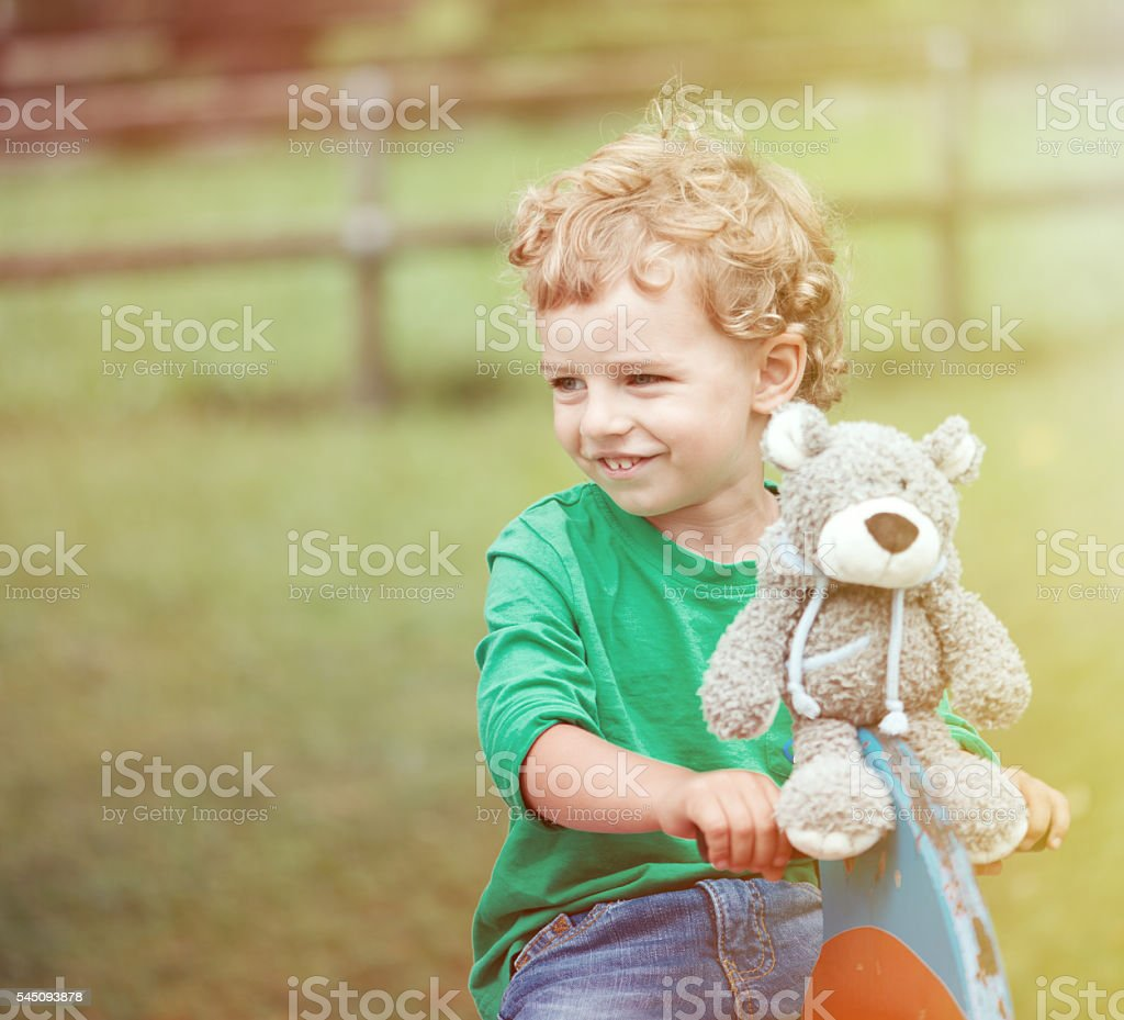 Child with His Bear Toy stock photo