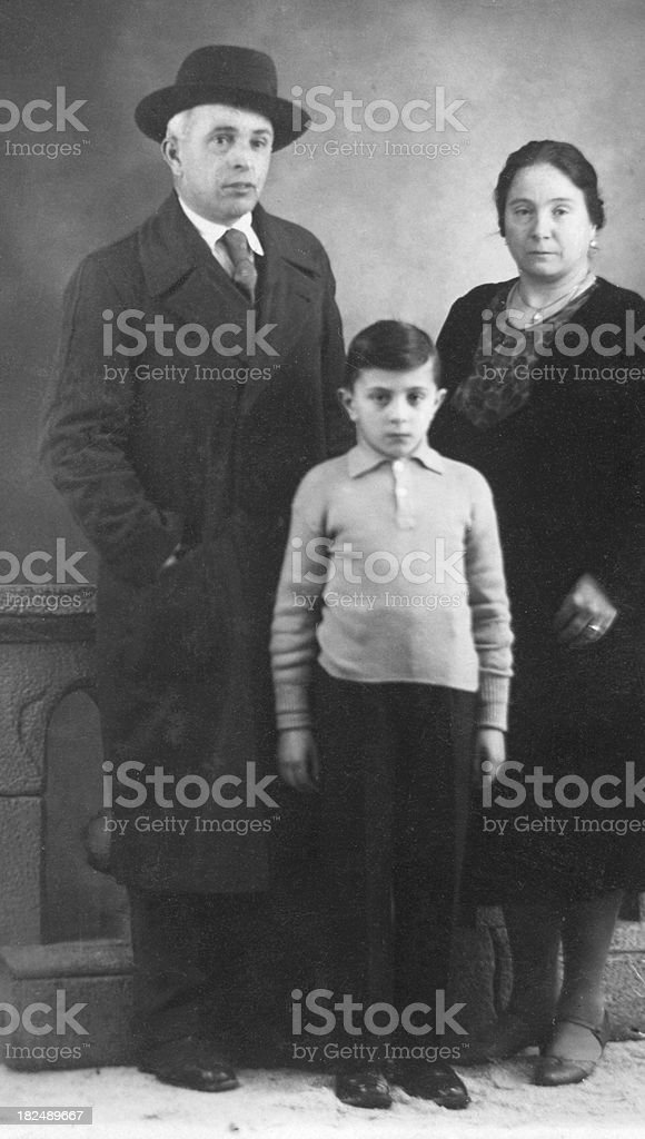 Child with his Parents in 1930.Black And White stock photo