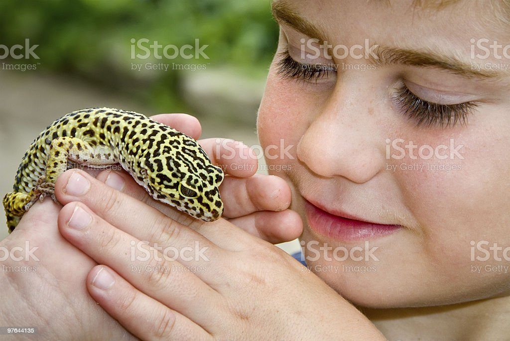 Child with Lizard stock photo
