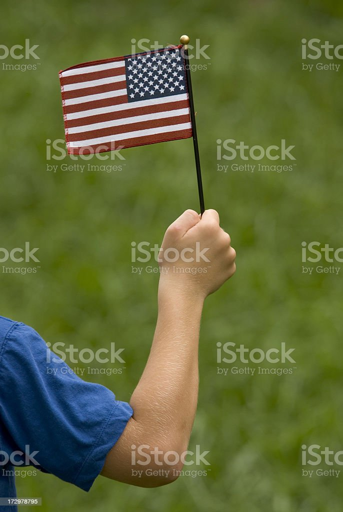 Child With Miniature Patriotic American Flag Blue Sleeve royalty-free stock photo