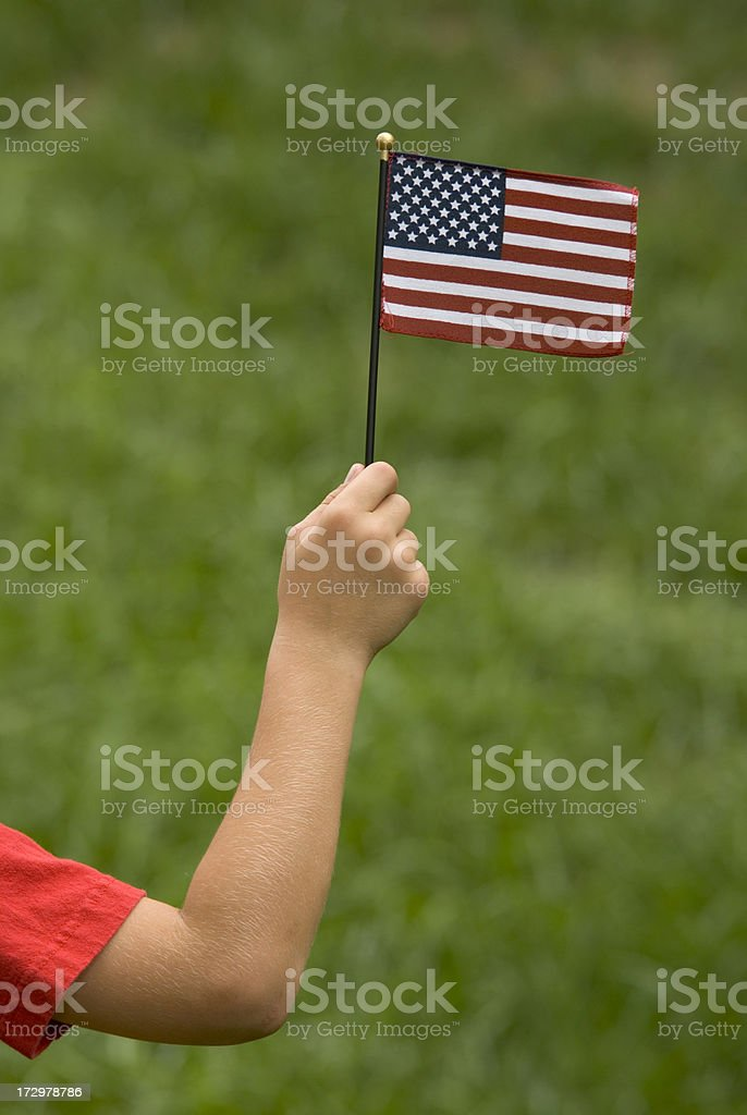Child With Miniature Patriotic American Flag Red Sleeve royalty-free stock photo