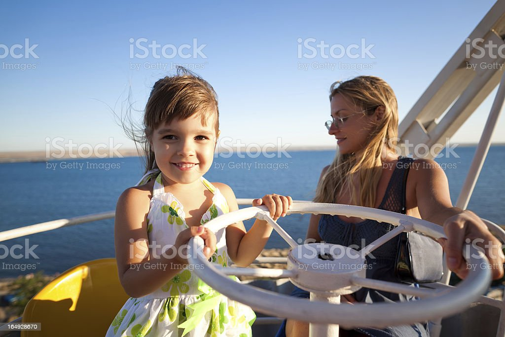 Child with mother at Ferris wheel stock photo