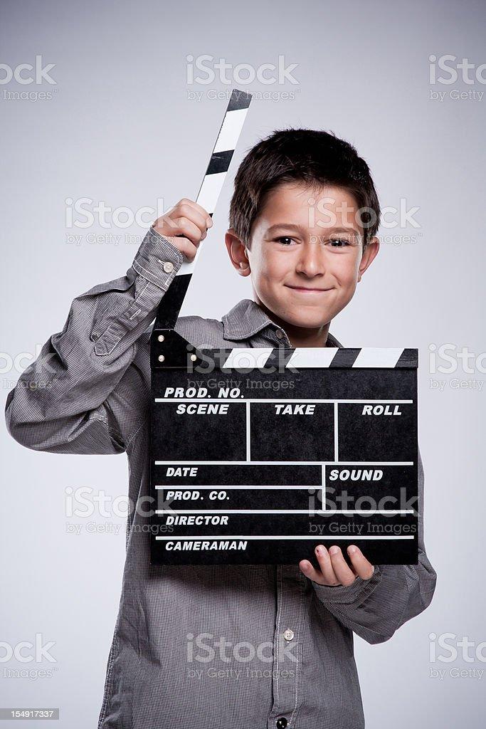 Child with movie clapper board. stock photo