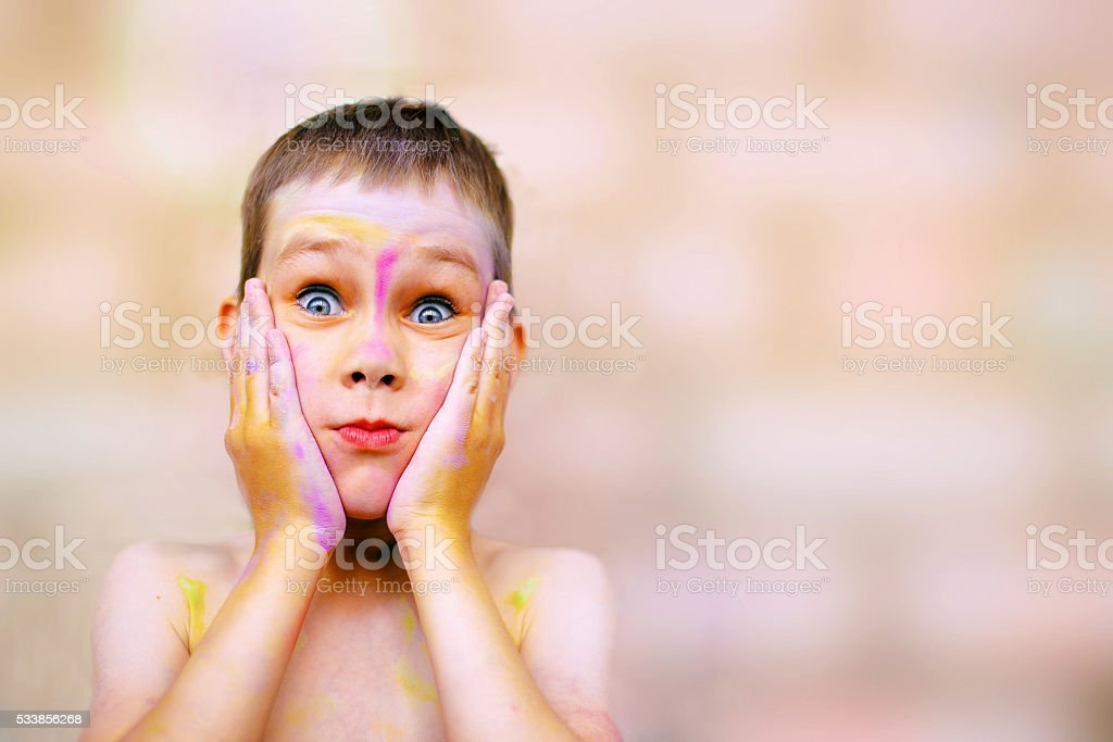 child with painted face very surprised stock photo