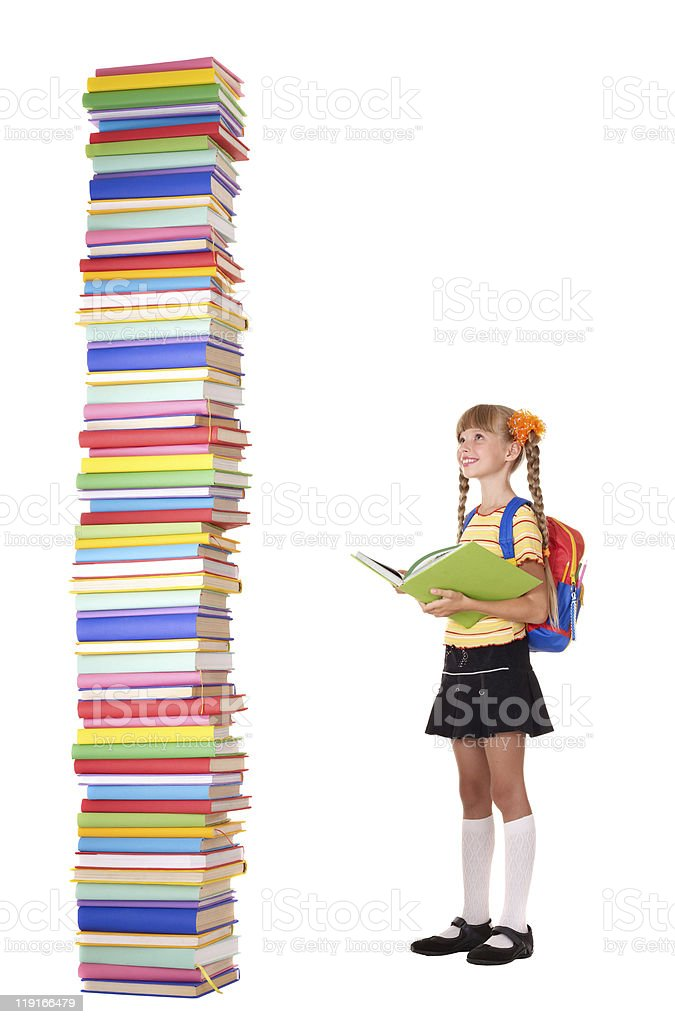 Child with pile of books. stock photo