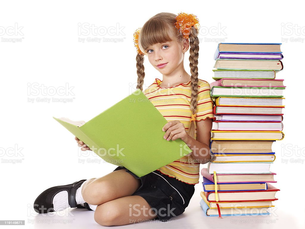 Child with pile of books reading on floor. royalty-free stock photo