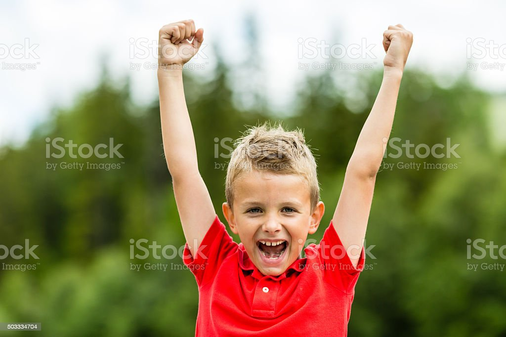 Child with raised fists stock photo